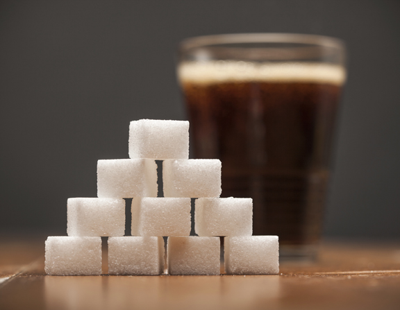 Amounts of Sugar In Food -  Glass of Soda, Cola, On wooden table and dark Background, Selective Focus